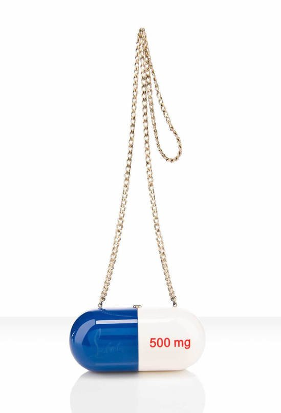 Christian Louboutins Pilule clutch is shaped like a pill