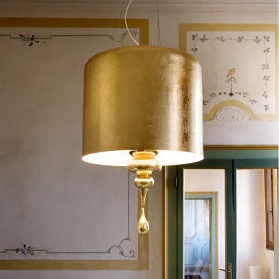 Eva Gold Lamps Topped With Golden Lamp Shades Shed Light On Opulence