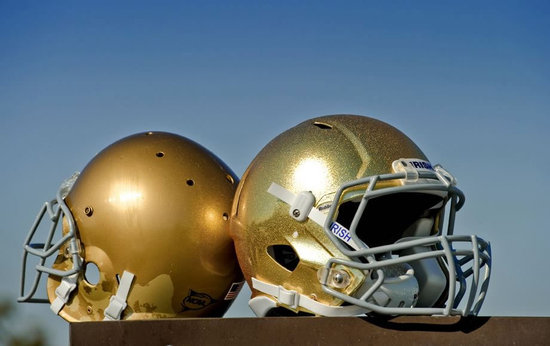 notre dame football team will don the new gold helmets