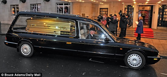 Sir-Jimmy-Savile-funeral-Gold-coffin-3.jpg