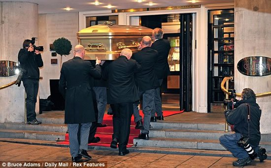 Sir-Jimmy-Savile-funeral-Gold-coffin-8.jpg