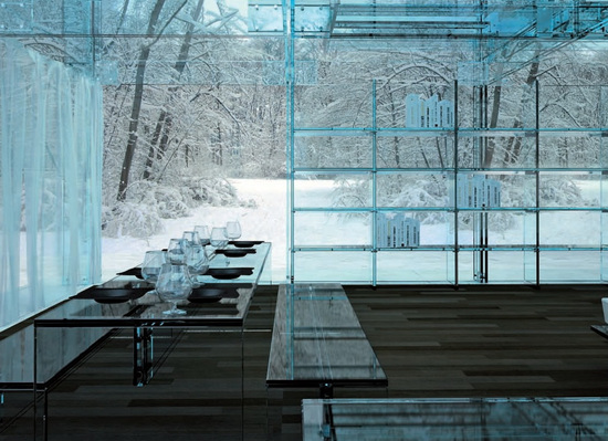 An all glass house offers spectacular views