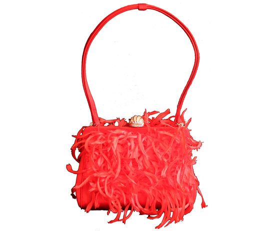 Marilyn Monroe's feather and silk purse auctioned for $25,428