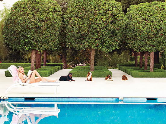 petra-ecclestone-poolside_the_manor.jpg