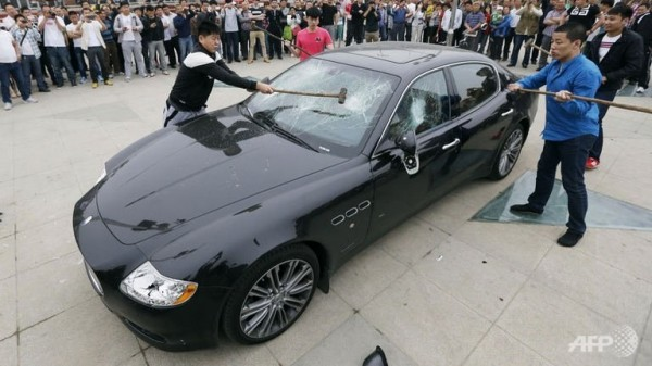Chinese man smashes his $420,000 Maserati Quattroporte in protest of bad service